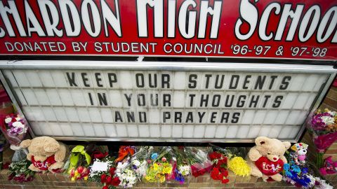 Flowers adorn the sign outside Chardon High School in Ohio on Tuesday.