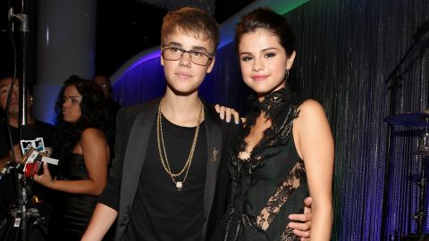 """Bieber attends the MTV Video Music Awards in August 2011 with a snake on one hand and then-girlfriend Selena Gomez holding on to the other. He won the best male video award for """"U Smile"""" that night."""