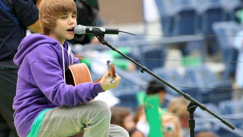 The Stratford, Ontario, native first attracted attention on YouTube. Here Bieber, in his signature purple hoodie, entertains crowds at Arthur Ashe Kids' Day, a U.S. Open event, in New York in August 2009.