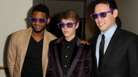 """The pop idol attends the Los Angeles premiere of """"Justin Bieber: Never Say Never,"""" a 3-D documentary on his rise to stardom, in February 2011. He's accompanied by Usher and manager Scooter Braun."""