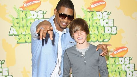 """At 15, Bieber had yet to become synonymous with the ubiquitous single """"Baby."""" At this point, he was soaking up all he could learn from his mentor, Usher, with whom he attended the Nickelodeon Kids' Choice Awards in March 2009."""