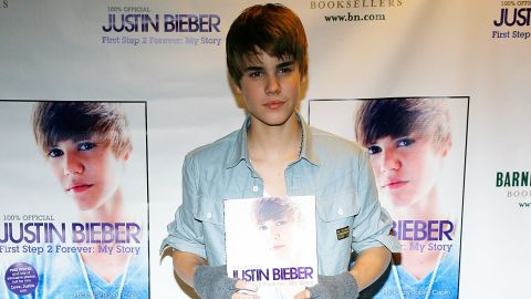 """At 16, Bieber was already an author. Here he promotes his book, """"First Step 2 Forever: My Story,"""" at a New York bookstore in November 2010."""