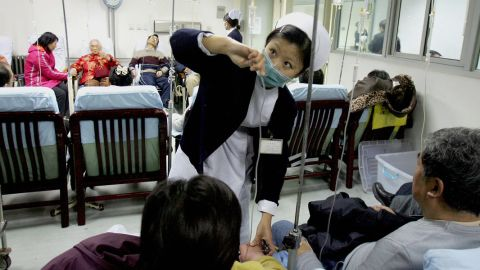 A nurse tends to patients at a Beijing hospital. The organ trafficking case allegedly involves doctors from state-run facilities.