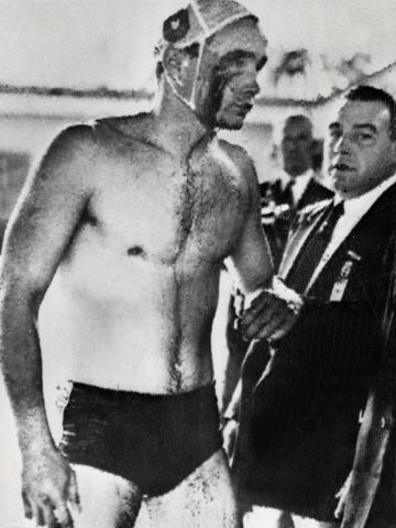 """Ervin Zador, Hungary's 21-year-old water polo star, emerges from the Olympic swimming pool in Melbourne with blood pouring from a cut beneath his right eye. The """"blood in the water"""" match against the Soviet Union in December 1956 came to represent Hungary's bloody struggle against its Communist oppressors."""