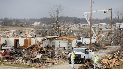 Utility workers try to restore electricity to a tornado-damaged section of Harrisburg on Friday.
