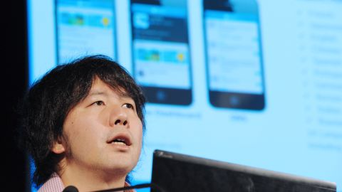 Gree CEO Yoshikazu Tanaka speaks during a press conference in Paris on February 21, 2012.