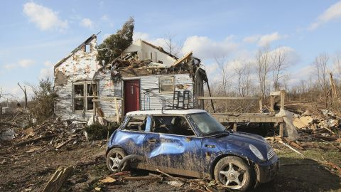 Debris from the violent tornado remains scattered around a Henryville home on Sunday.