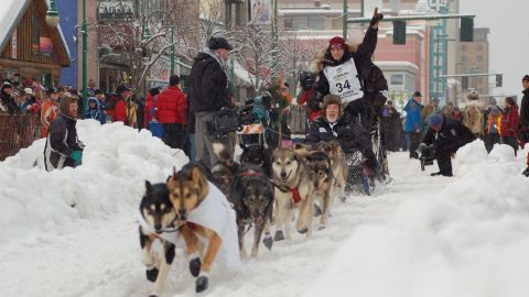 Fans cheer teams Saturday in Anchorage during the race's ceremonial start.