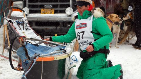 A musher preps his sled in Anchorage Saturday.