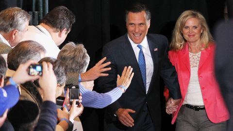 Mitt and Ann Romney, smiling after primary wins on Super Tuesday.