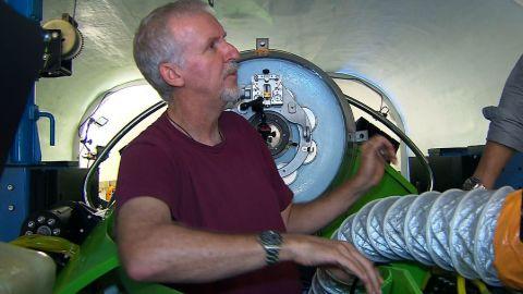 Filmmaker James Cameron is seen inside his single-pilot submersible, the Deepsea Challenger.