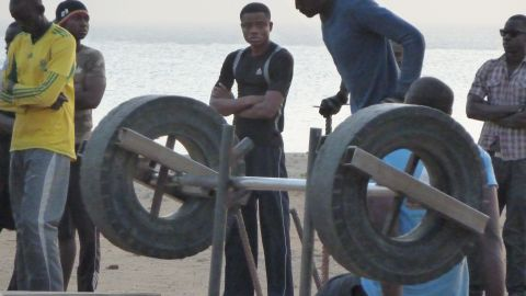 Lacking the money to use a proper gym, some men have built a makeshift gym of their own using whatever materials they can, such as car tires.