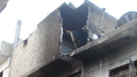 CNN correspondent Arwa Damon walks through battered and defiant Homs, Syria.