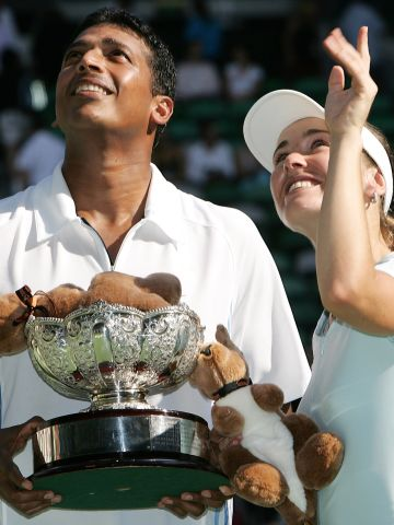 Bhupathi's 11 grand slam titles have come with a total of eight different partners. Here he celebrates his mixed doubles success at the 2006 Australian Open with former women's world No. 1 Martina Hingis of Switzerland.