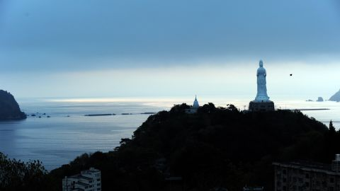 A huge Buddha statue looks over the bay in 2011 in the tsunami-devastated city of Kamaishi, Japan.