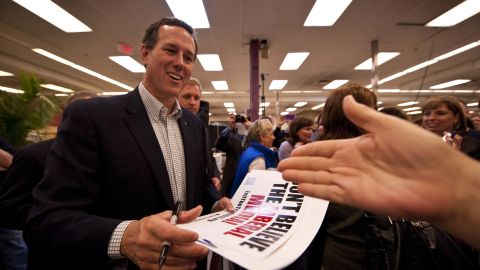 Rick Santorum greets supporters at a small business in Lenexa, Kansas, during a campaign stop this week.