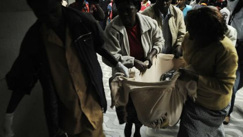 A wounded man is brought into the hospital on March 10 after a bomb at a bus station in Nairobi that left at least 6 dead.