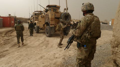 U.S. soldiers guard a military base near Alkozai village after the shooting of Afghan civilians in Panjwayi district, Kandahar on March 11, 2012.