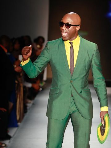"""Ozwald Boateng, a British designer of Ghanaian descent, takes to the runway in one of his distinctive creations. Boateng was presented the """"Lifetime Achievement Award"""" at the event."""