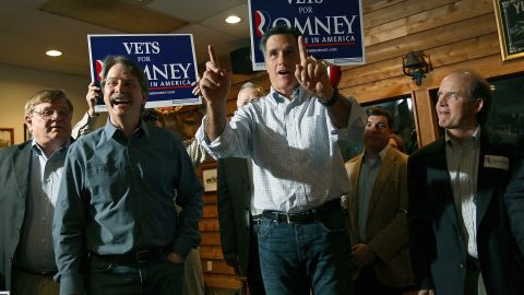 Mitt Romney makes a campaign appearance with comedian Jeff Foxworthy at the Whistle Stop cafe in Mobile, Alabama.