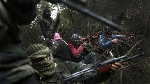 Members of the rebel Free Syrian Army, gather in a mountainous area of the restive Idlib province on March 13, 2012.