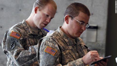 "Veterans Michael Futch (R) and Logan Remillard (L) register for the ""Hiring Our Heroes"" job fair November 4, 2011."