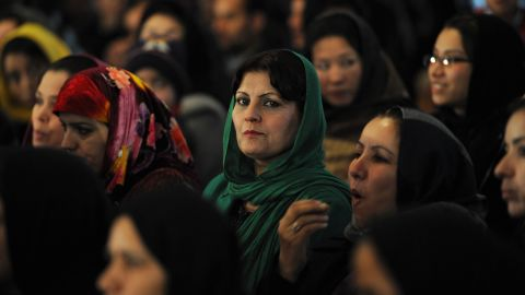 Afghan women listen to President Karzai speak March 11. Critics say he is selling out women's rights to woo the Taliban.