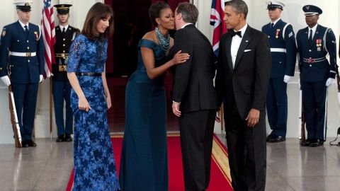 US President Barack Obama and First Lady Michelle Obama stand alongside British Prime Minister David Cameron and his wife, Samantha Cameron, as they arrive for a State Dinner as part of an official visit on the North Portico of the White House in Washington, DC, March 14, 2012. AFP PHOTO / Saul LOEB (Photo credit should read SAUL LOEB/AFP/Getty Images)