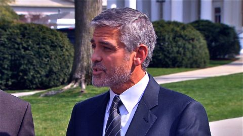 Clooney talks to the press after meeting with the president Thursday.