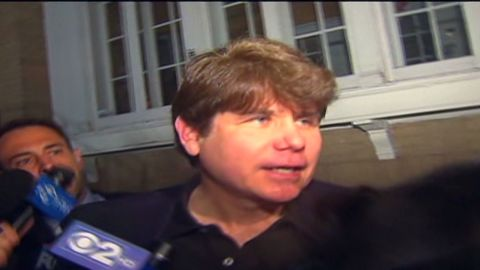 vo blagojevich departs house for prison_00000607