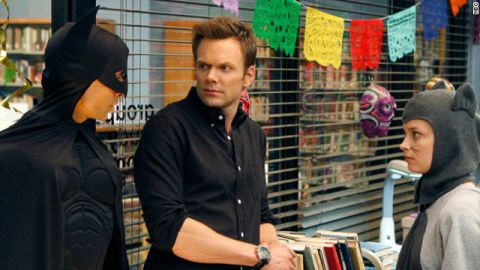Danny Pudi's character, Abed, shows off his Batman costume to first season costars Joel McHale and Gillian Jacobs.