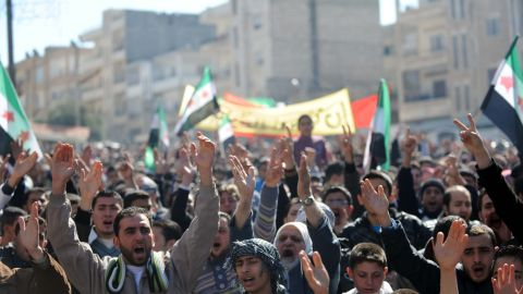 Syrian demonstrators shout slogans during an anti-regime protest in the centre of Idlib in northwestern Syria on February 24, 2012.