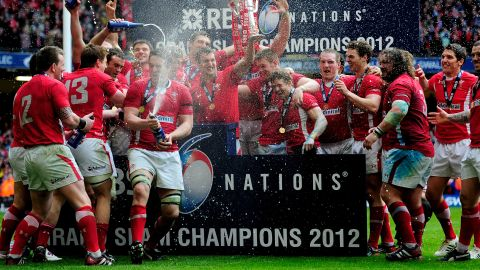 Wales players celebrate after clinching the Six Nations Grand Slam with victory against France at the Millennium Stadium.