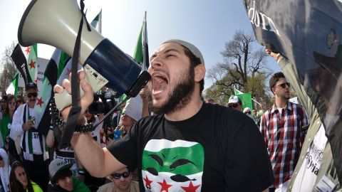 According to organizers, more than 1,200 protesters, many of them Syrian-Americans, attended the rally.