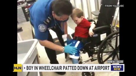 wheel chair kid tsa pat down_00001626