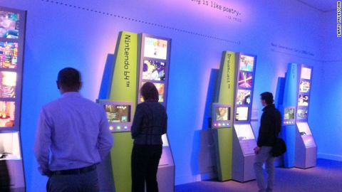 """Visitors at """"the Art of Video Games"""" exhibit at the Smithsonian American Museum of Art."""