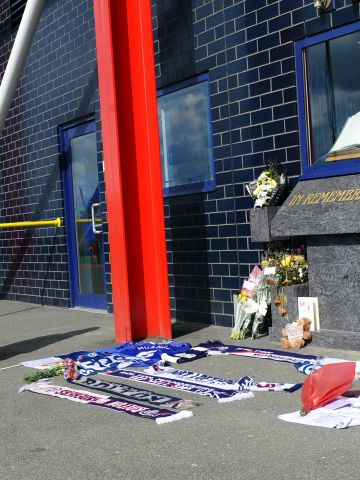 Bolton Wanderers fans have left flowers and scarves outside the English club's Reebok Stadium in support of Muamba, while most of the playing squad have been to visit him in the London Chest Hospital.