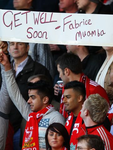 Fans at Liverpool's FA Cup quarterfinal against Stoke City send their best wishes to Muamba. Supporters also chanted his name at various points during Sunday's Anfield match.