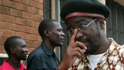 Zimbabwean activist Munyaradzi Gwisal leaves court in Harare Monday after being convicted of planning Egypt-style protests.