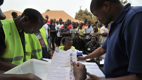 Electoral offciers count ballot papers at the polling station on March 18, 2012 in Guinea Bissau.