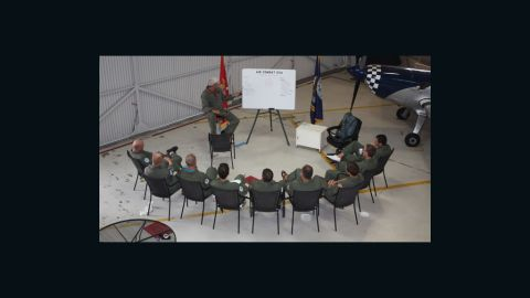 Corporate participants are briefed ahead of taking to the skies for a dogfight.