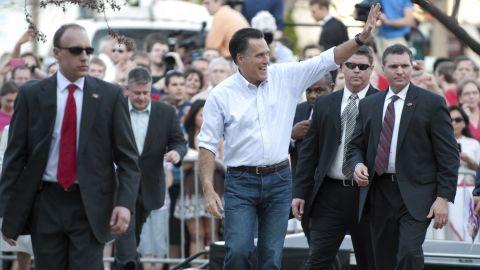 Mitt Romney waves to supporters Monday at Bradley University in Peoria, Illinois.