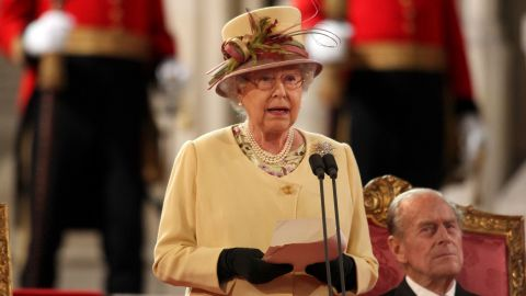 Queen Elizabeth II addresses both Houses of Parliament as Prince Philip, looks on, in Westminster Hall.