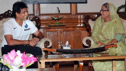 Tendulkar visited the residence of Bangladesh's Prime Minister Sheikh Hasina Wazed, right, to mark his achievement.