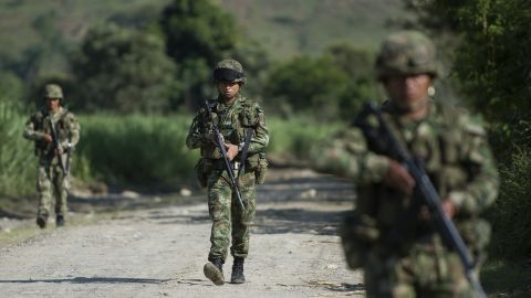 Colombian soldiers patrol along a dirt road in Miranda, Colombia, on January 18, 2012.