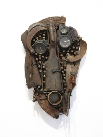 A tribal-inspired mask made from a rifle butt, bullets and other military equipment by Mozambican sculptor Goncalo Mabunda.