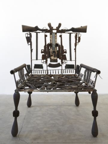 """Mabunda, who has exhibited in Paris, Tokyo and Dusseldorf, is best known for his chairs, or """"thrones,"""" representing power."""