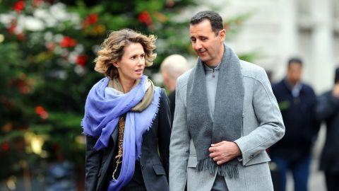 Syrian President Bashar al-Assad and his wife, Asma, walk along a Paris street in 2010. The couple share flirtatious e-mails.