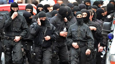 French members of the RAID special police forces unit leave after the assault on shooting suspect Mohammed Merah on March 22, 2012