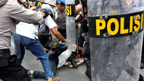 Police arrest a protestor during clashes at a demonstration against a rise in fuel prices earlier this week.